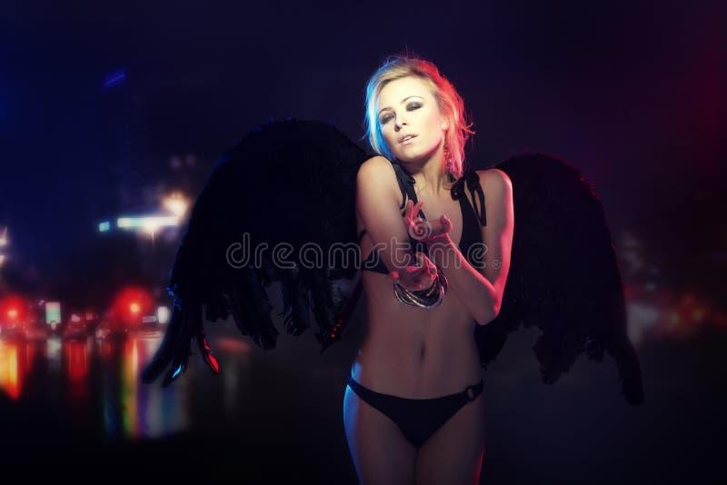 Dark angel in the city stock photos
