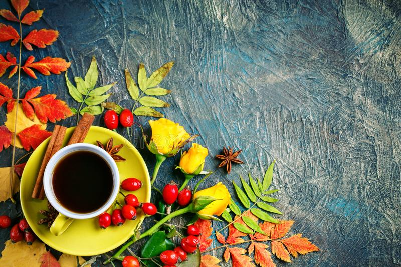 Dark autumn background with Cup of coffee and autumn leaves. stock photos