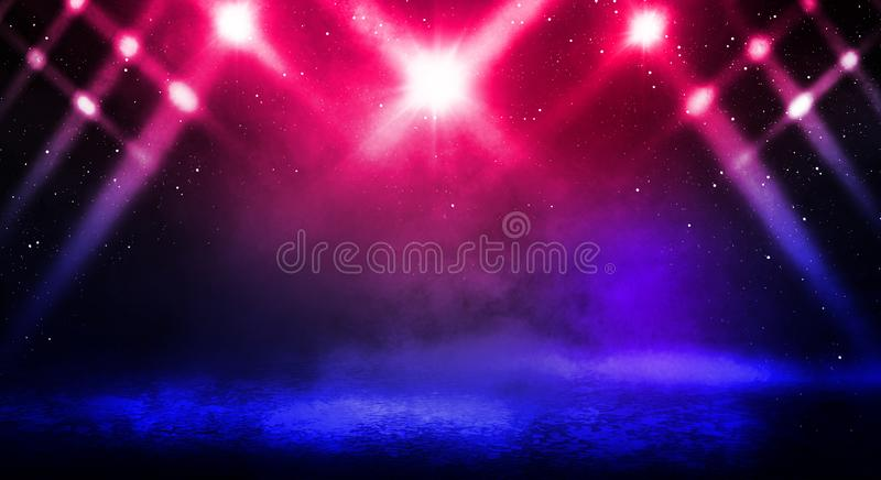 Dark background of the street, thick fog, spotlight, blue and red neon. Abstract background with neon lights, night view stock photography