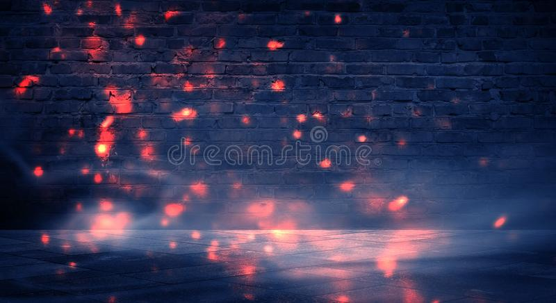 Dark basement room, empty old brick wall, sparks of fire and light on the walls and concrete floor. Dark background with smoke and stock photo
