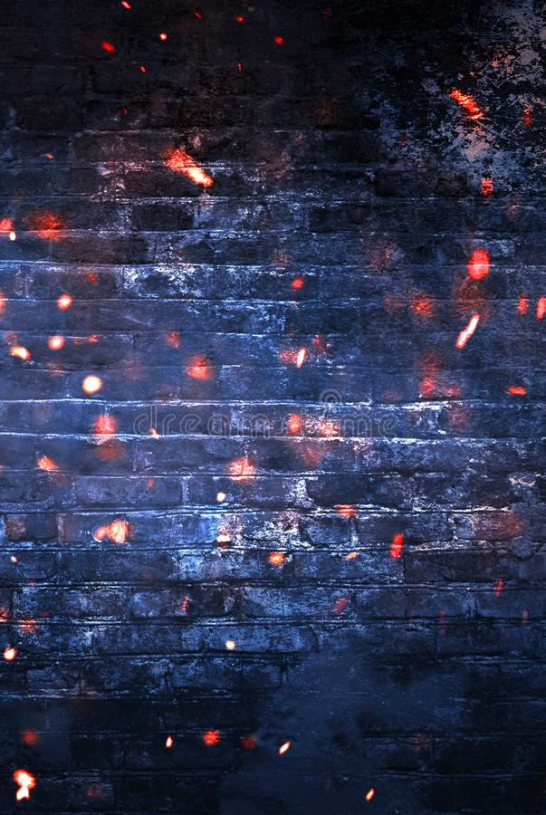 Dark basement room, empty old brick wall, sparks of fire and light on the walls and wooden floor. Dark background with smoke and bright highlights. neon lamps royalty free stock images