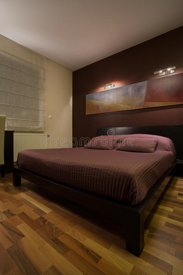 Dark bedroom with enormous bed. View of dark bedroom with enormous bed stock photo