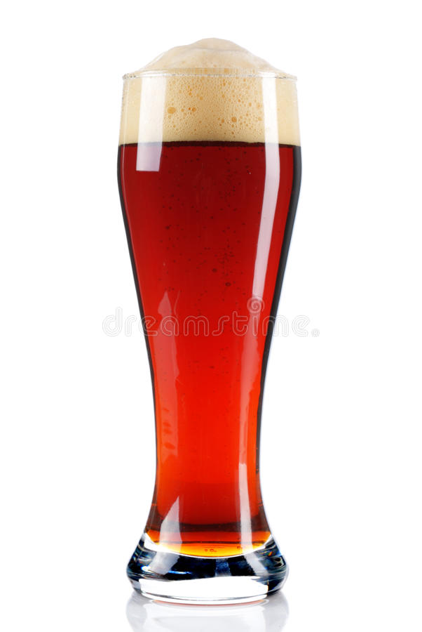 Dark beer. In a glass on white stock photography