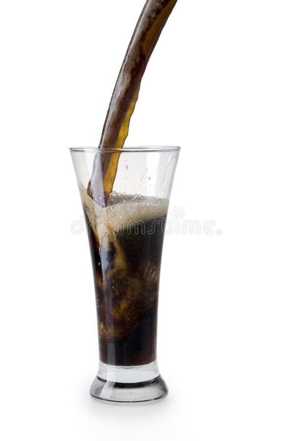 Dark beer being poured into a glass royalty free stock images