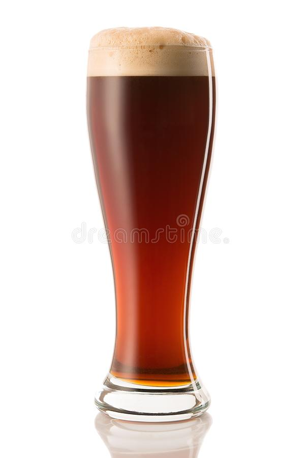 Dark beer in a glass, isolated on a white background.  royalty free stock image
