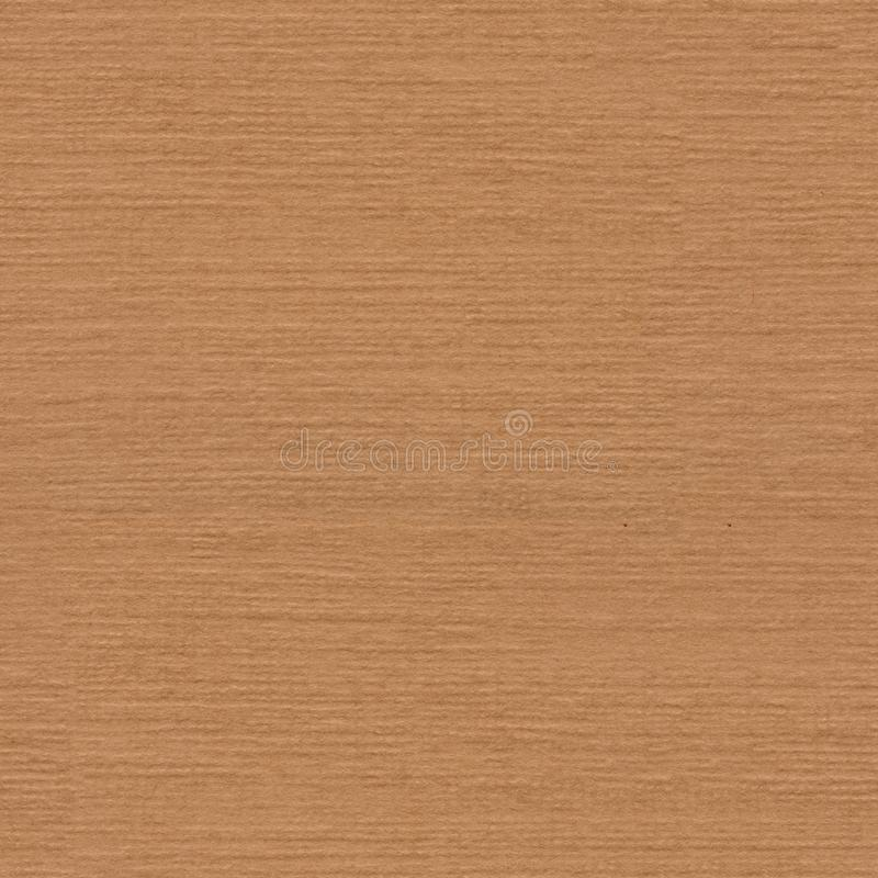Dark beige natural paper background. Seamless square texture, tile ready. High quality texture in extremely high resolution royalty free stock images