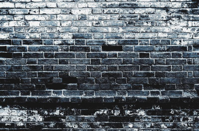 Dark black blue distressed dirty old brick wall texture background stock photography