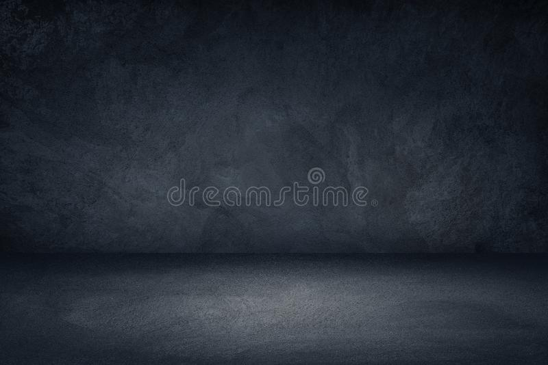 Dark black and blue grungy wall background for display or montage of product stock images