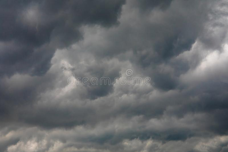 Dark or black clouds on the sky before storm raining. Clouds background royalty free stock photo