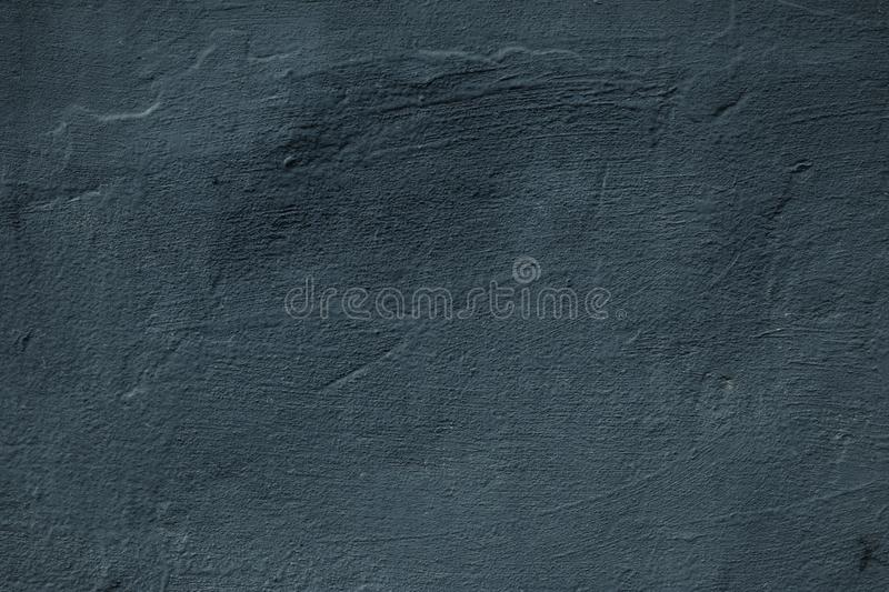 Dark, black concrete wall. Messy painted wall. Grey cement rock effect. Grunge background. Urban dirty rough stone surface, textur. E. Abstract natural pattern stock photos