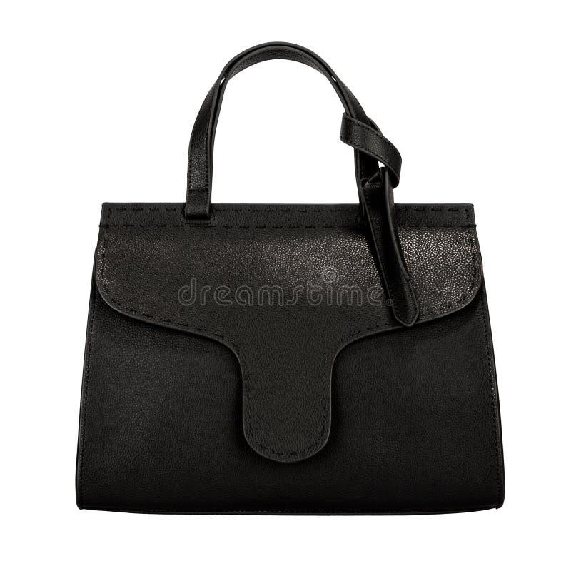 Dark black female leather bag isolated on white background. One dark black female leather bag isolated on white background royalty free stock photos