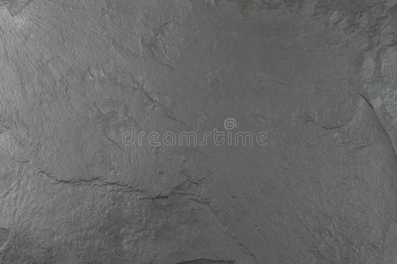 Dark black slate board. Texture chipped stone. Slate tile. Building material. Place for your text stock photos