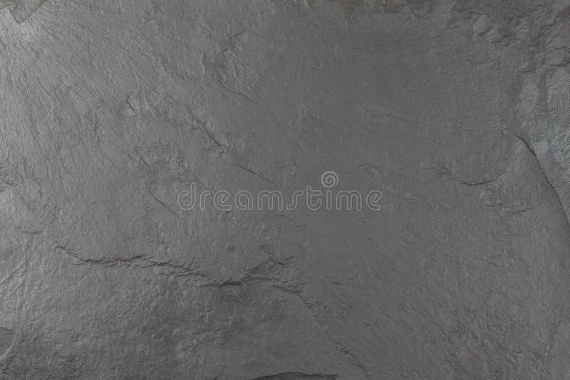 Dark black slate board. Texture chipped stone. Slate tile. Building material stock photos