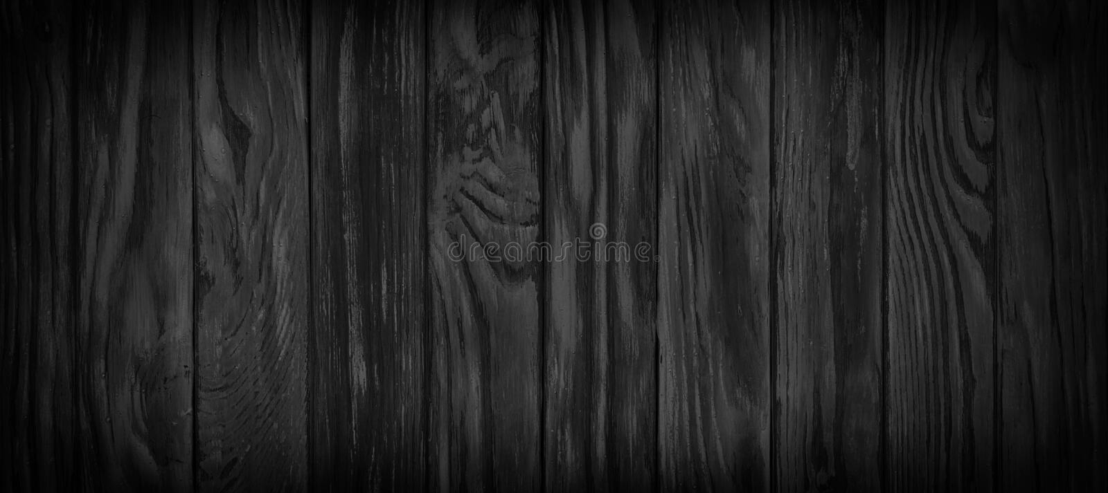 Panorama of black wooden boards, gloomy wood texture, dark background royalty free stock photos
