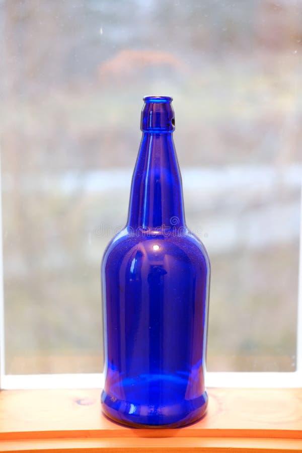 Blue bottle as a decor stock photo