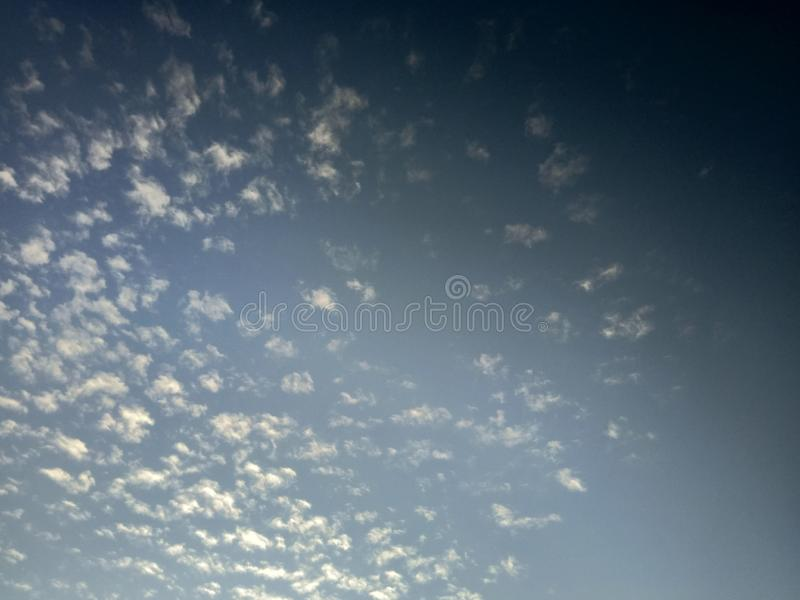 Dark blue cloud with white light sky background and light midnight evening time.  royalty free stock images