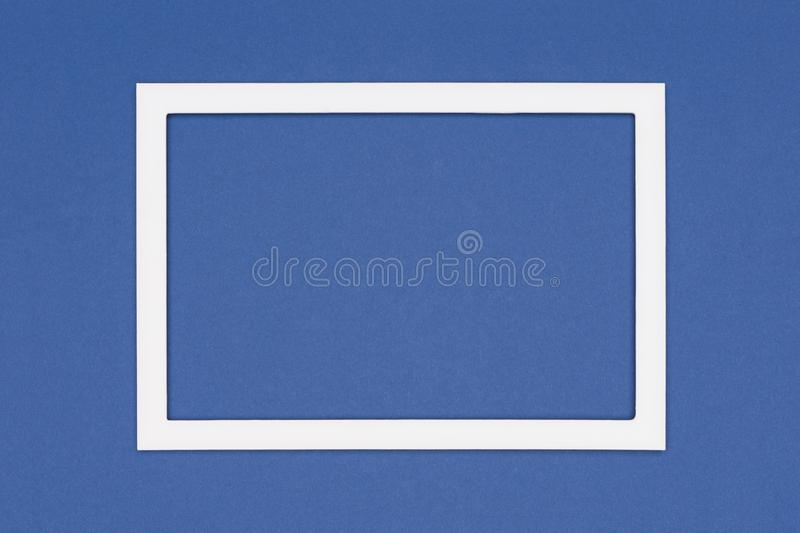 Dark blue colored paper texture minimalism background. Minimal template with empty picture frame mock up. Abstract flat lay dark blue colored paper texture stock photography