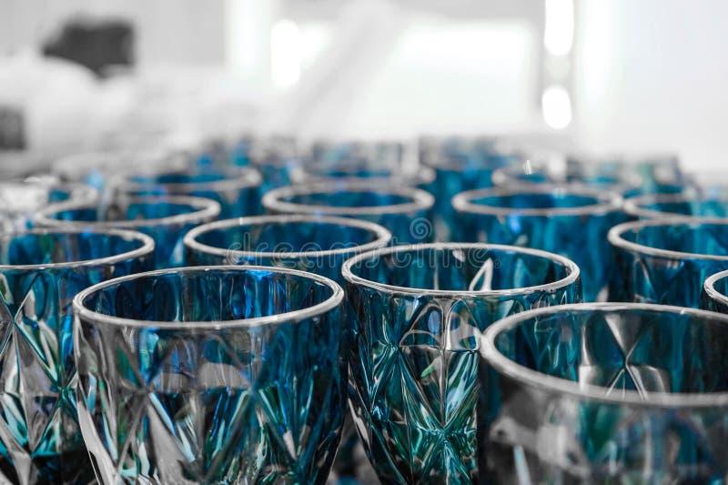 Dark blue cystal pattern glasses on the table prepared for luxury dinner event. Dark blue cystal pattern glasses on the table prepared for luxury  dinner event stock images