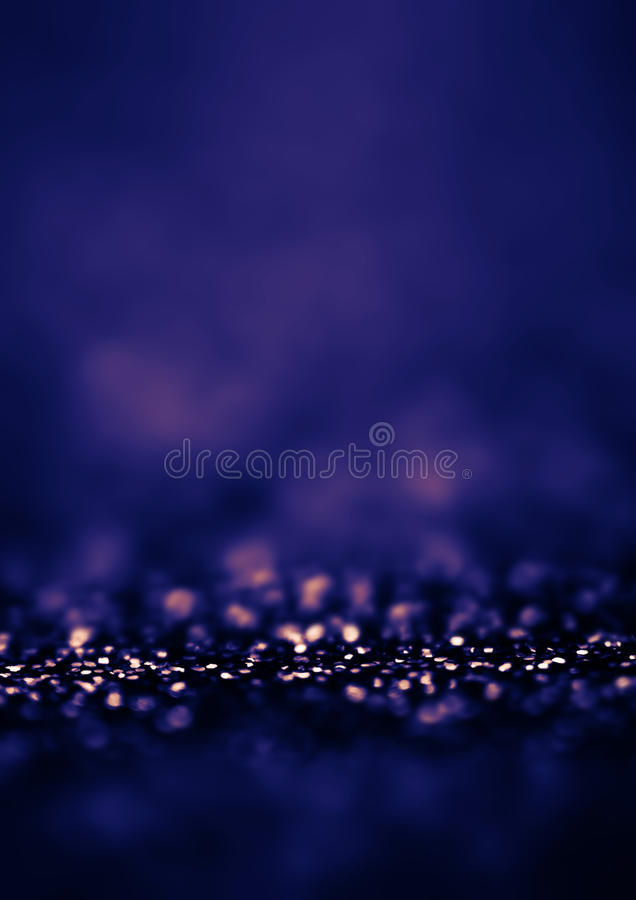 Dark Blue Defocused Bokeh twinkling lights Vintage background. F royalty free stock images