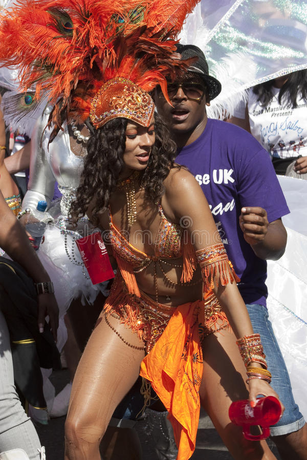 A Dark In Blue Dress At Notting Hill Carnival Editorial Stock Photo