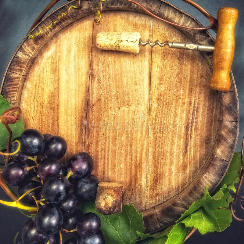 Dark blue grapes on wooden barel stock photo