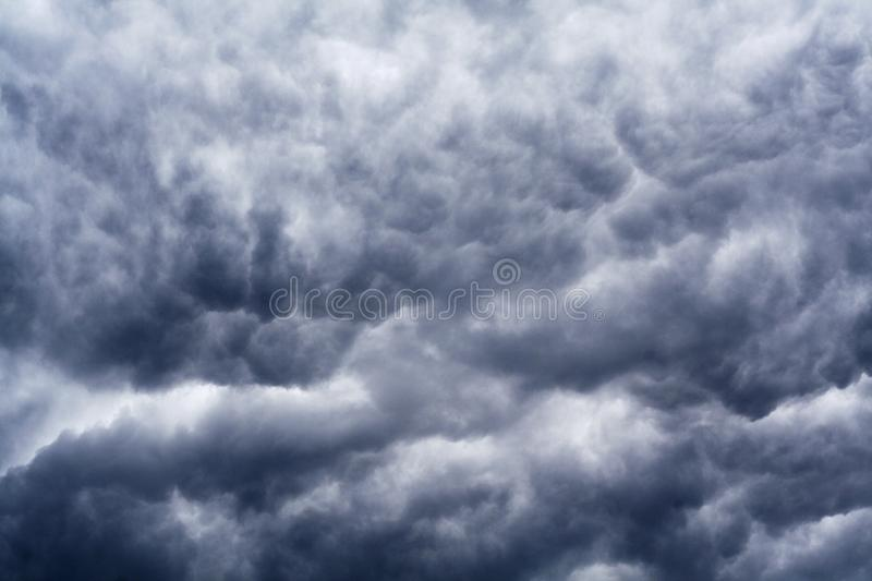 Dark blue and grey dramatic clouds stock image