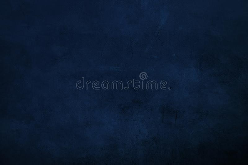 DArk blue grungy canvas background or texture with dark vignett. Grungy painting draft background or texture royalty free stock image