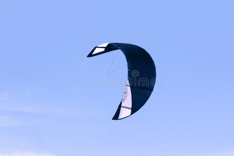 Dark blue kiteboarding kite against blue sky. Close-up kiteboarding kite against blue sky royalty free stock photography