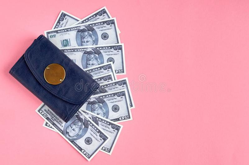 Dark blue leather wallet with money on pink background composition. Flat lay and top view photo, cash, dollar, purse, 50, layout, above, bright, card, concept stock image