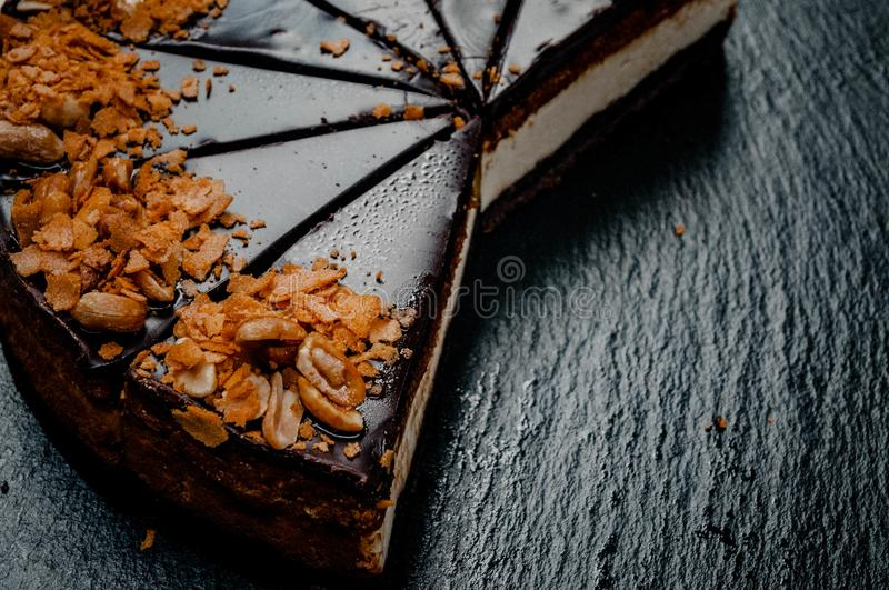 Cheesecake on a marble plate royalty free stock image