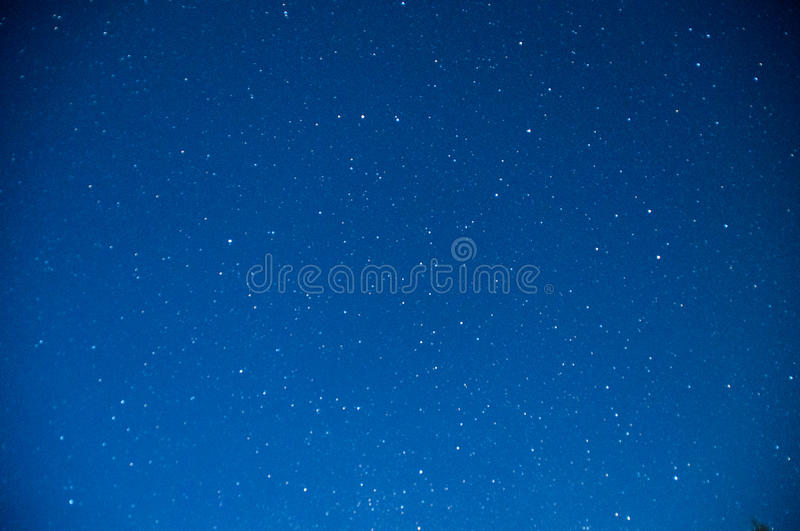 Dark blue night sky with stars stock photography