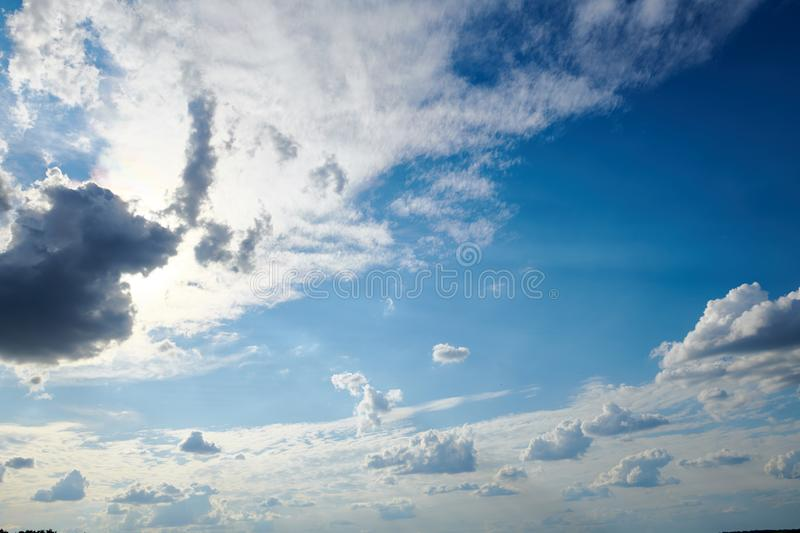 Dark blue sky with clouds for background or texture stock photo