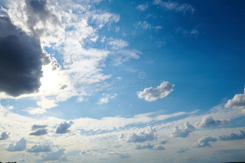 Dark blue sky with clouds for background or texture stock photography