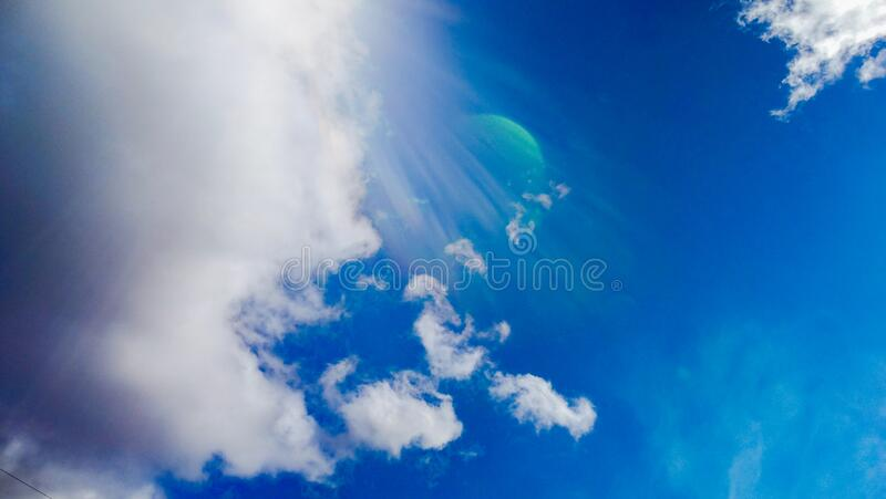 Dark Blue Skyscape White Grey Fluffy Clouds & Planet. Dark Blue Skyscape White Grey Fluffy Clouds royalty free stock image