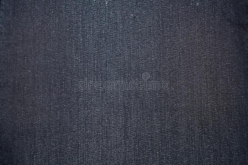 Dark blue texture of denim or blue jeans background. royalty free stock photography