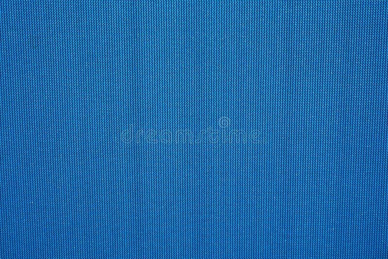 Dark blue texture of dense fabric. Seamless pattern stock photography