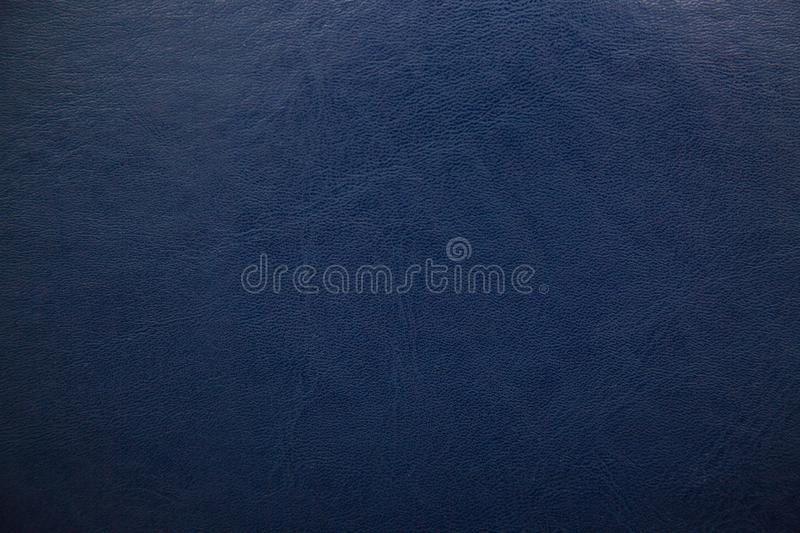 Dark blue textured leather background. Abstract leather texture.  stock image