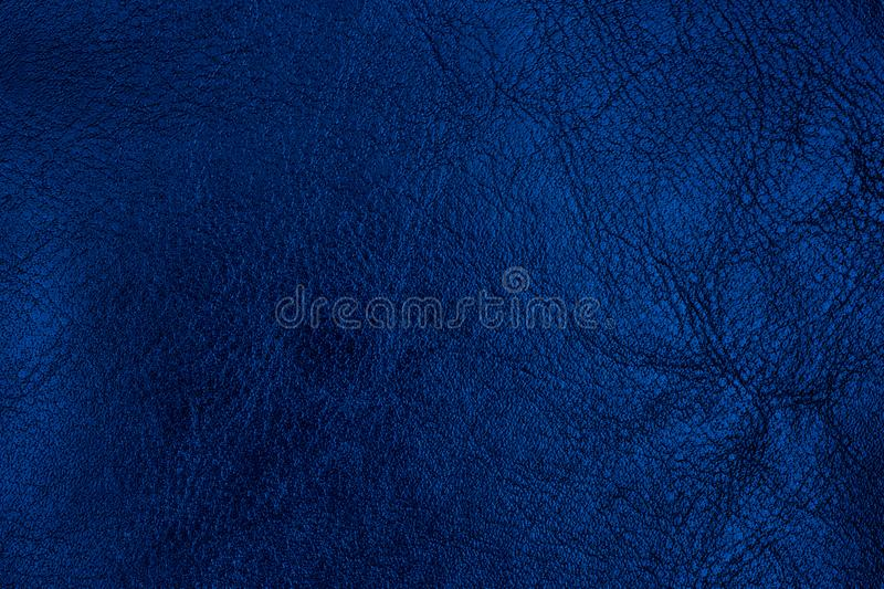 Dark blue textured leather background. Abstract leather texture royalty free stock photos