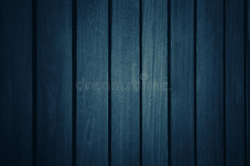 Dark blue tone background with many patterns and textures of plank in vertical with straight lines. For wallpapers royalty free stock images