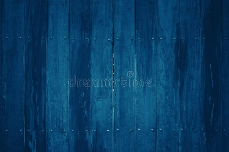 Dark blue tone background with many patterns and textures of plank in vertical with straight lines. For wallpapers royalty free stock image