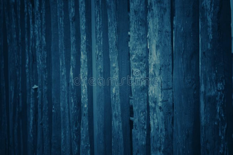 Dark blue tone background with many patterns and wood texture. For wallpapers and vertical lines stock photos