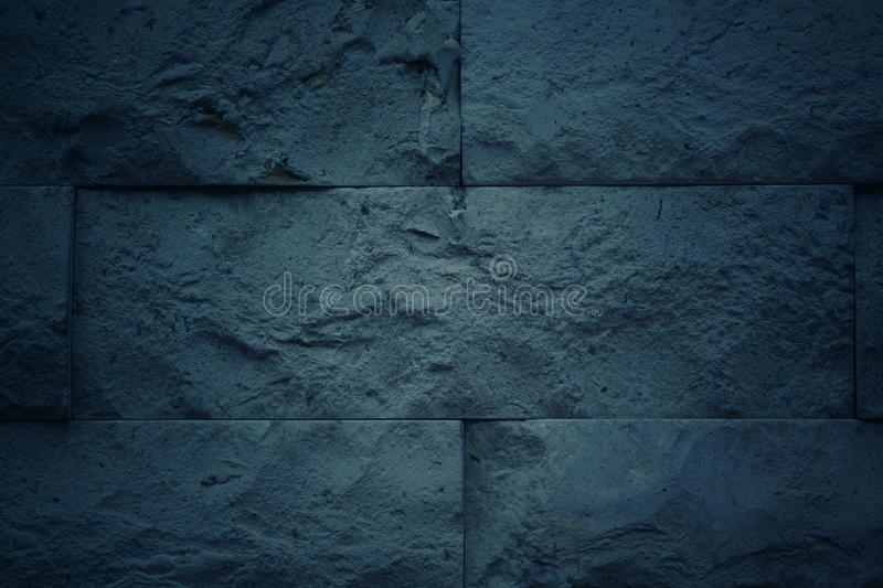 Dark blue tone background with pattern and texture of brick. For background and wallpaper stock photo