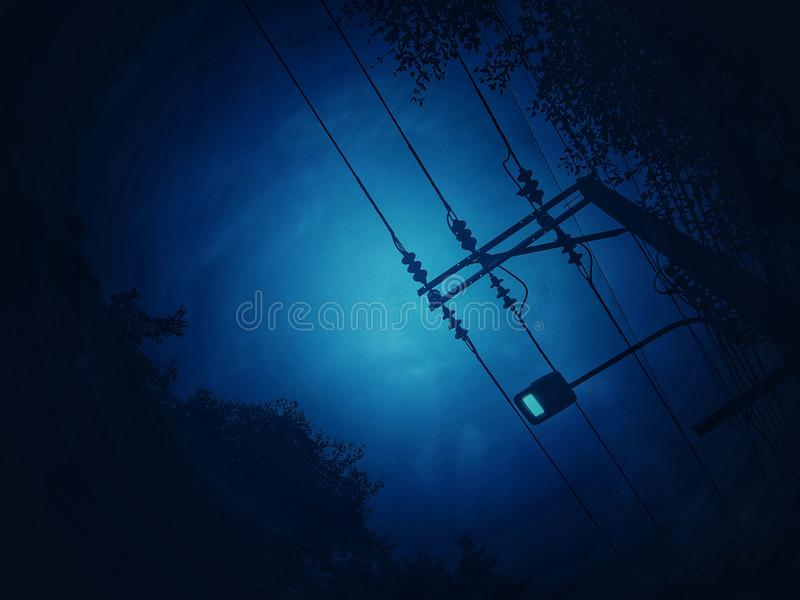 Dark blue tone background with shadows of trees and electricity poles and street lamp. For night and wallpapers royalty free stock photos