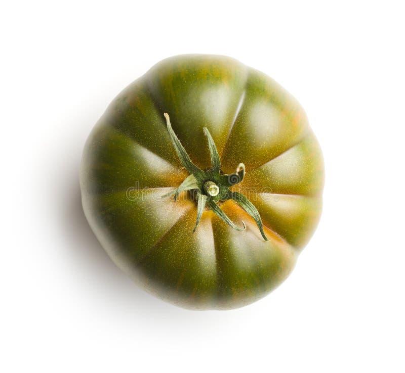 Dark brandywine tomato. Isolated on white background stock photos