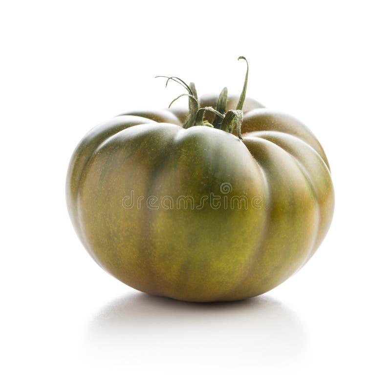 Dark brandywine tomato. Isolated on white background stock image