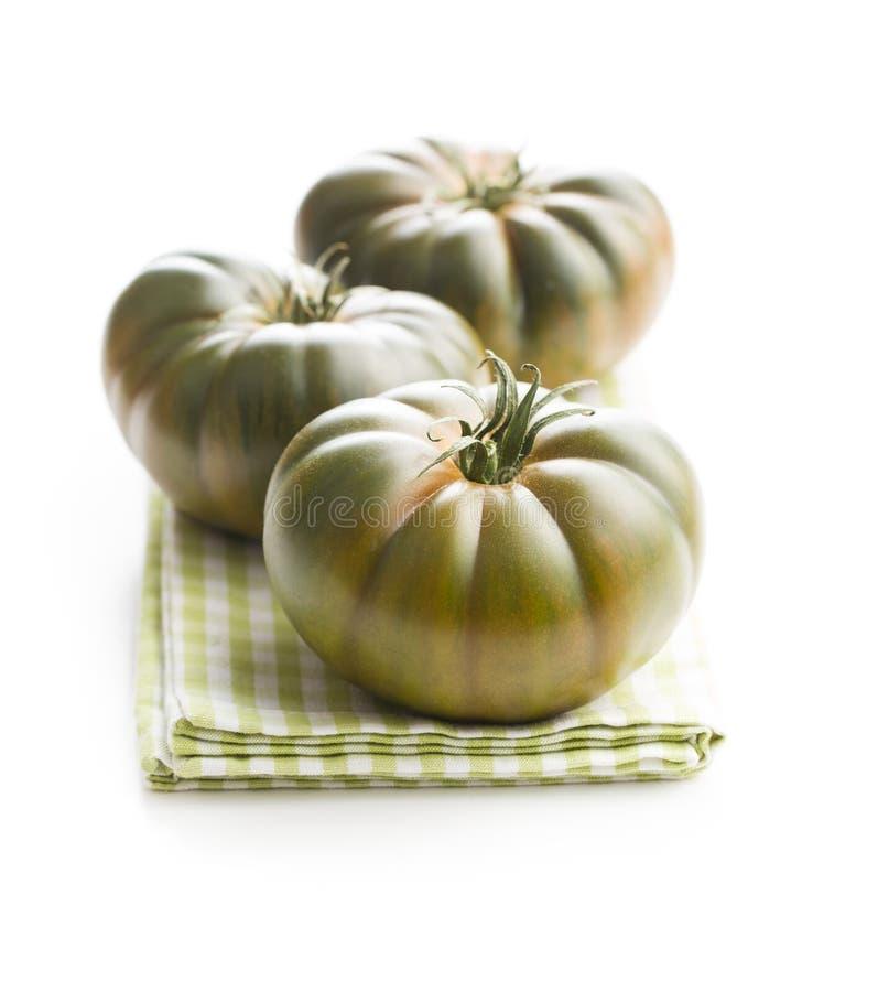 Dark brandywine tomatoes. Isolated on white background stock photo