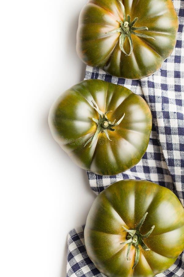 Dark brandywine tomatoes. Isolated on white background stock image