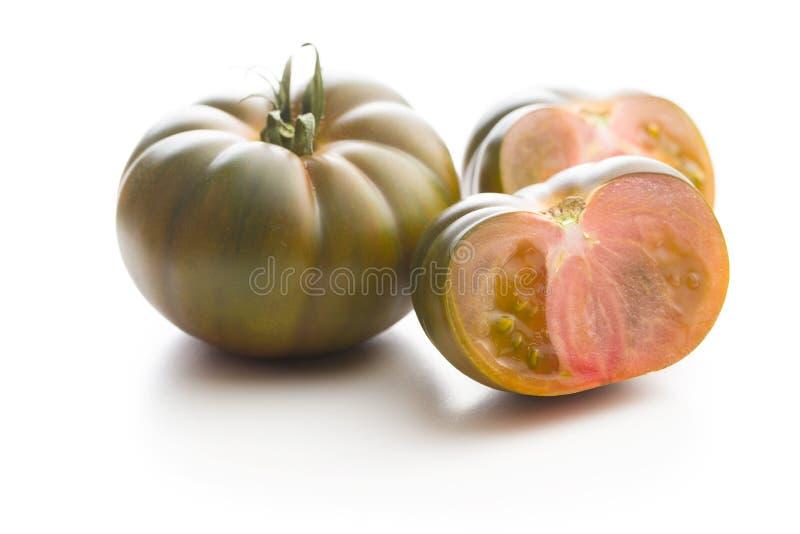 Dark brandywine tomatoes. Isolated on white background royalty free stock images