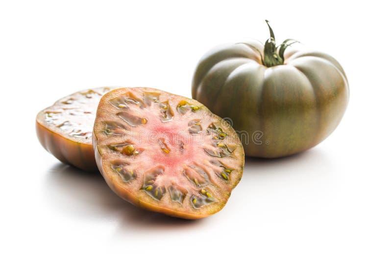 Dark brandywine tomatoes. Isolated on white background stock photos