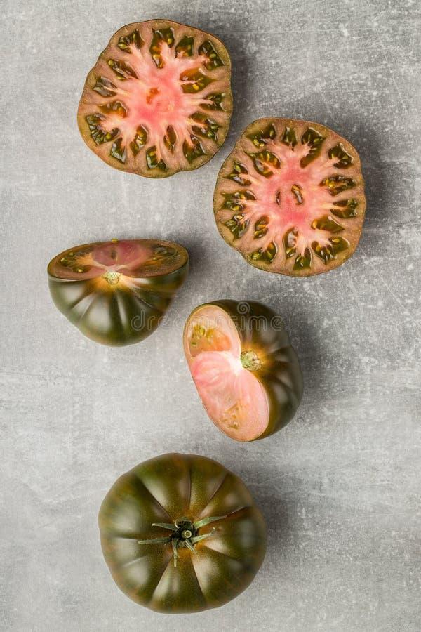 Dark brandywine tomatoes. On kitchen table. Top view royalty free stock photos